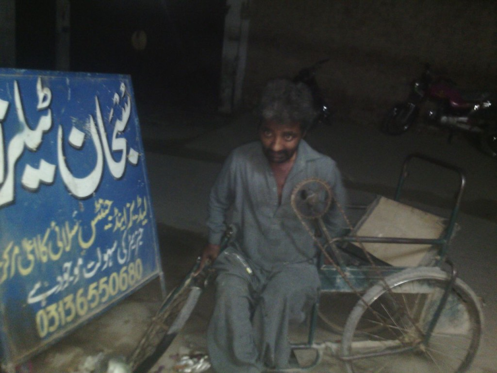 Falak Sher, in front of the shop he works at