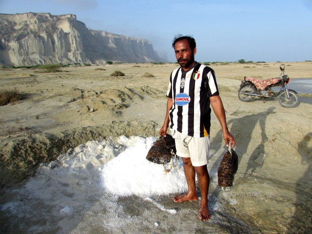Imetan Baloch stands next to dried salt (Source: PakVoices)